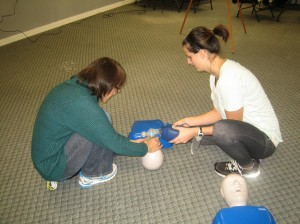 Trainees using an adult training mannequin