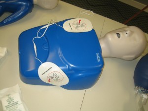 AED Trainer placed on CPR training mannequin